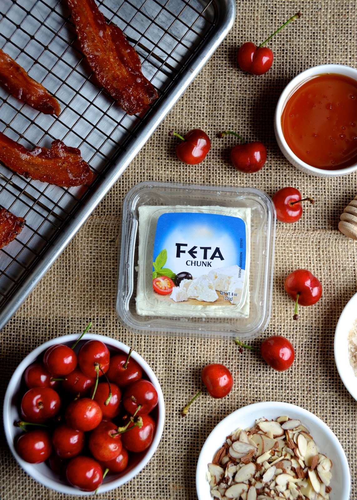 Baked Feta with Cherry, Bacon & Almonds - Always Order Dessert