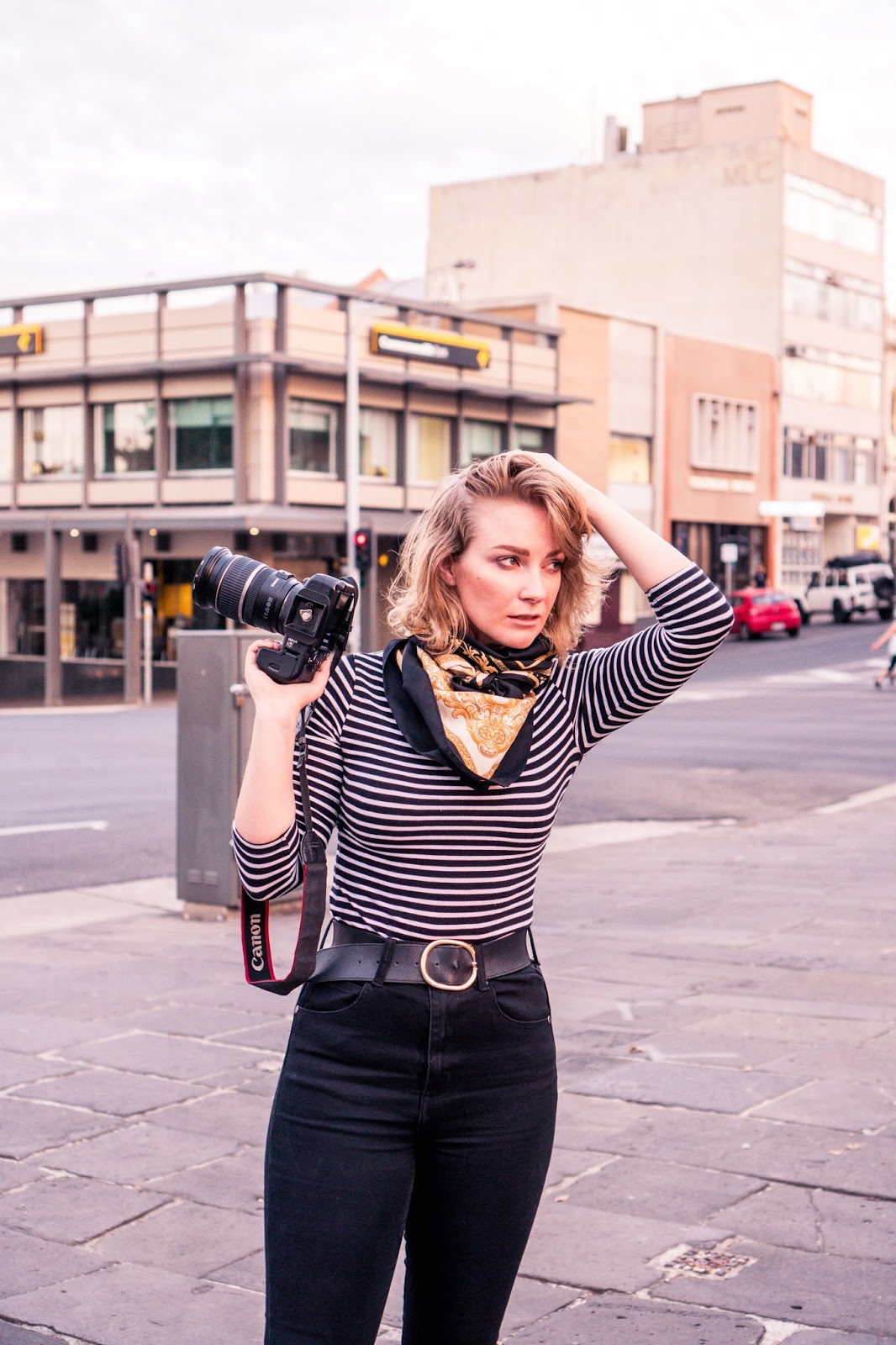 Liana of @findingfemme shoots wearing black skinny jeans and black and white striped top