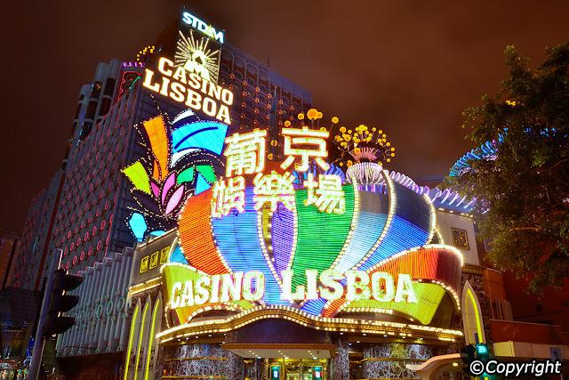 Macau's casino company wants to call half a billion dollars in virtual money