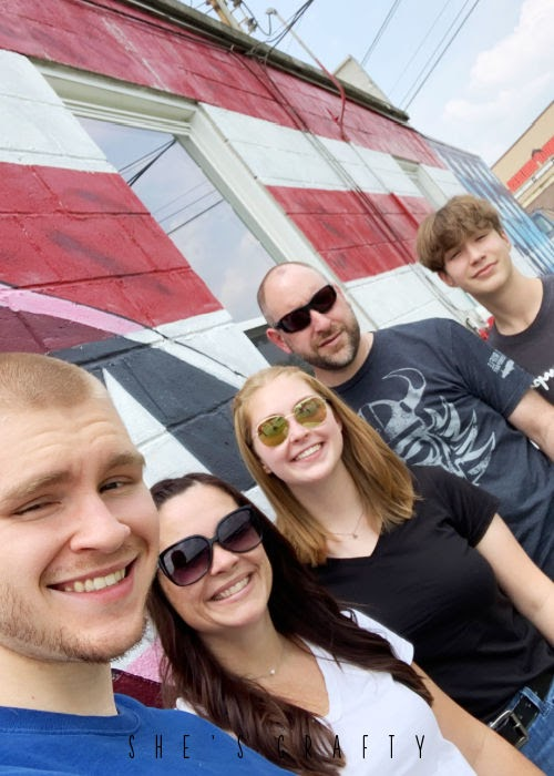 Family photo in front of flag mural in Murfreesboro TN.