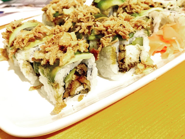 Soft shell crab sushi rolls, topped with avocado and crispy onions