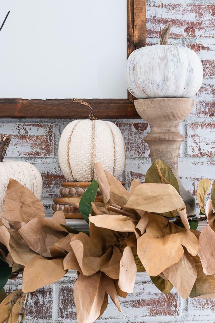paper leaf garland with neutral pumpkins