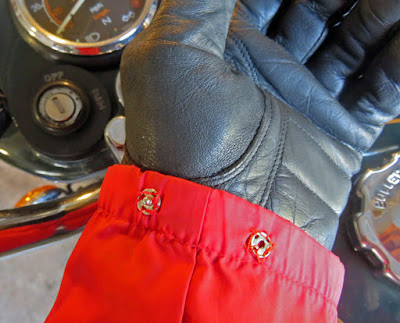 Sleeve of jacket show snaps sewn on cuff.