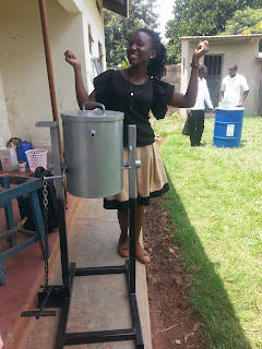 Anna next to her large-scale hand washing station