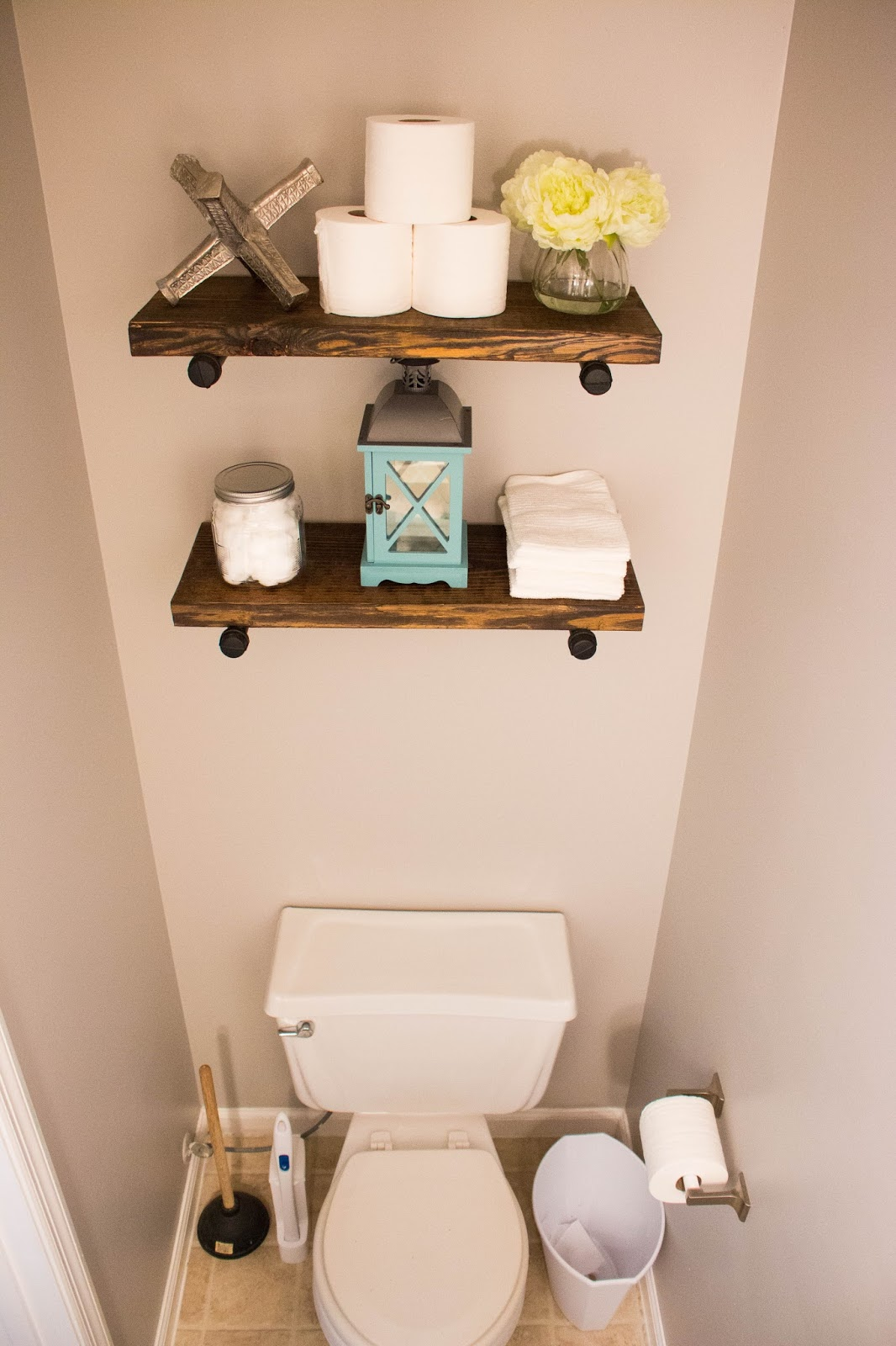 the powder bathroom how to make industrial floating shelves the rh thehappyflammily com powder room shelving ideas decorating powder room shelves