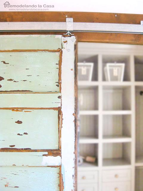 vintage green door in boy room closet