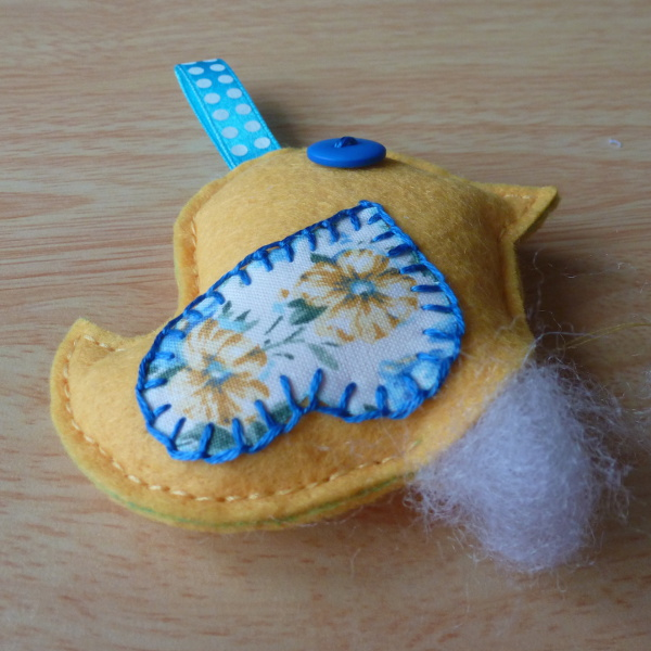 Adding fiber fill into the plush hanging bird ornament design