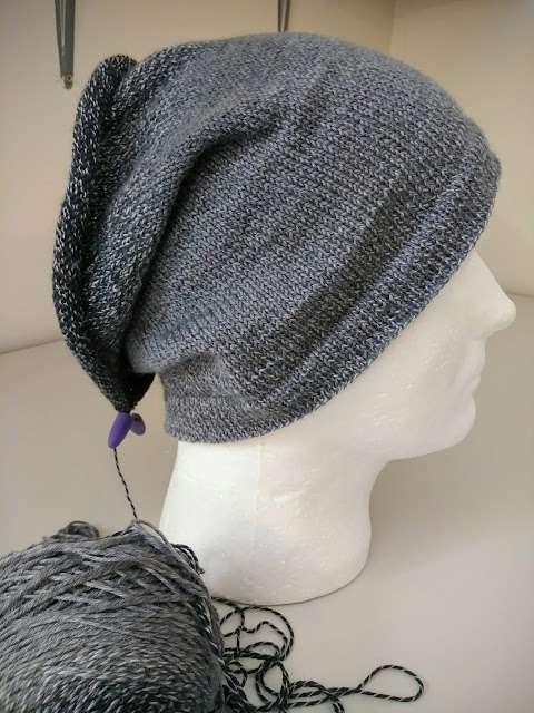 Simple stockinette stocking cap knit with gradient sock yarn.