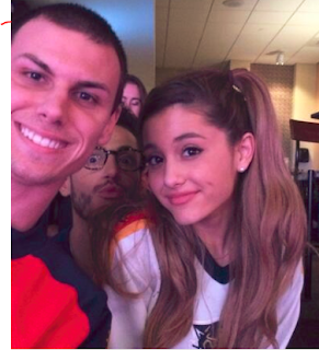 Image of Ariana Grande with fan Ryan Keelan @ryankeelen at the Florida Panthers game