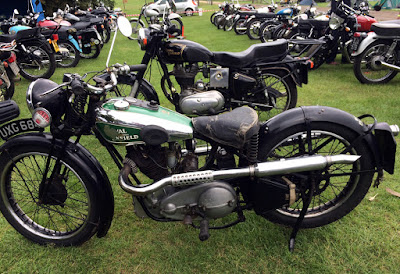 Vintage Royal Enfield on display at event.