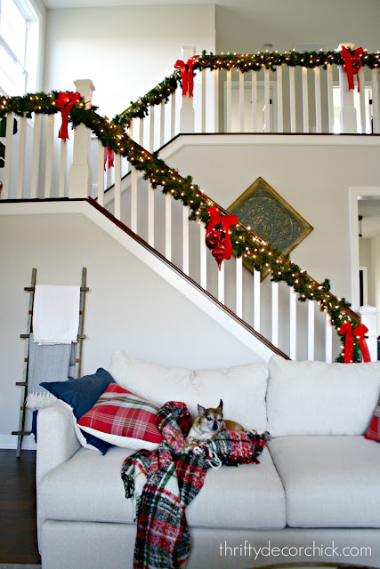 Open staircase with Christmas greenery