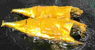 Frying two full fish on pan or tawa for fish fry recipe