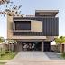 Fachada de casa contemporânea com design arrojado + paisagismo e iluminação!