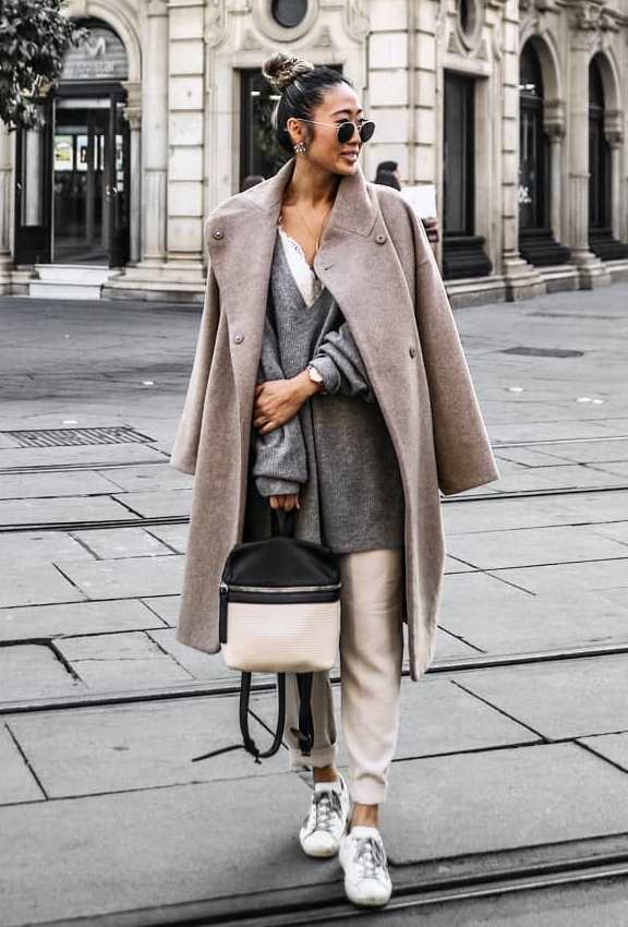 how to wear a cashmere coat : sneakers + backpak + grey sweater + bag