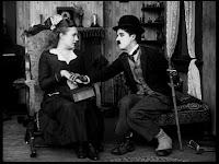"""Кадр из к/ф Чарли Чаплина """"Солнечная сторона"""" / Sunnyside (1919) - 29"""