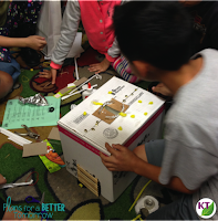 Students love to share their STEM challenge designs with the class. They field questions and discuss what they'll do in the next iteration.