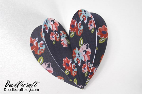 Make a heart shape pop up card for Valentine's day with 3 patterned paper hearts