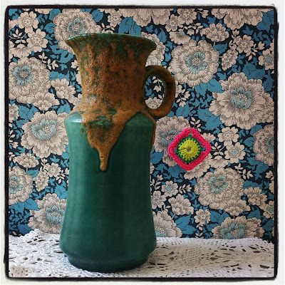 ByHaafner, vase, thrifted, blue wallpaper with flowers, doily, neon pink, granny square, crochet