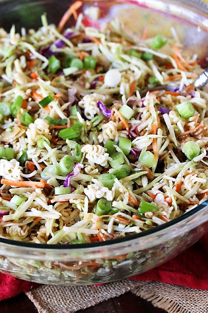 Mixing Bowl of Asian Ramen Noodle Salad with Broccoli Slaw Image