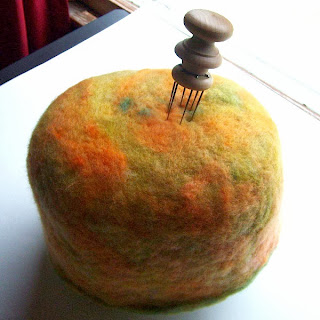 needle felted wool hat on foam base