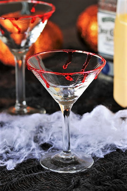 Corn Syrup Blood Drips on Martini Glass Rim Image