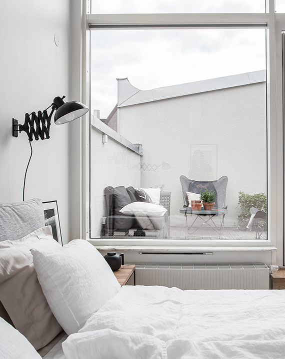 Scandinavian bedroom with terrace via Alvhem