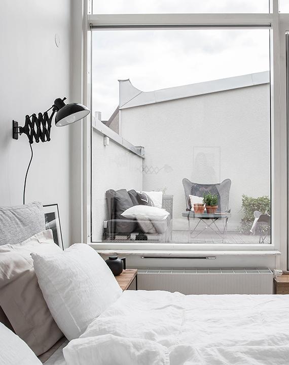 Scandinavian bedroom with terrace via Alvhem