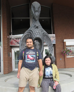 TG and William at the Raven statue at the Alaska Native Heritage Center