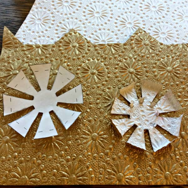 paper template and gold embossed paper disc on embossed paper background