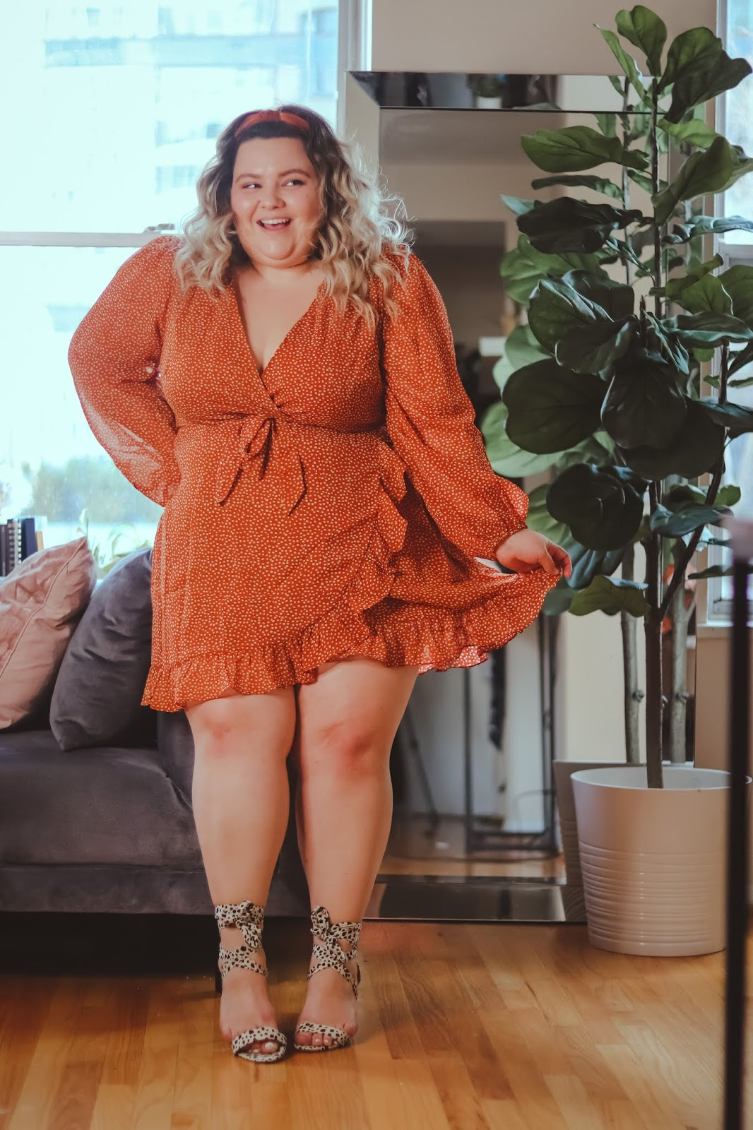 Chicago Plus Size Petite Fashion Blogger, influencer, YouTuber, and model Natalie Craig, of Natalie in the City, shares her latest work from home outfit Adore Me's ready to wear ruffle mini dress.
