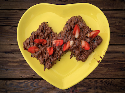 Waffles with chocolate and strawberry stock image