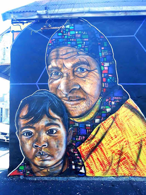 Mural of two people by Silas