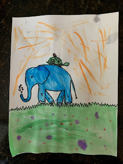 A drawing of a blue elephant with a turtle on its back walking on grass.