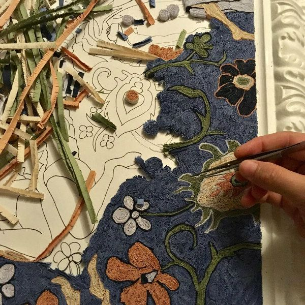 detail of a fringed paper carpet in progress
