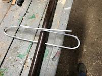 Bent into a paper clip shape