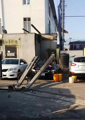 Photos: No casualties recorded as electric pole falls & smashes a car in Lekki, Lagos