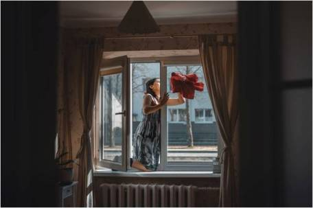 A woman cleaning her windows