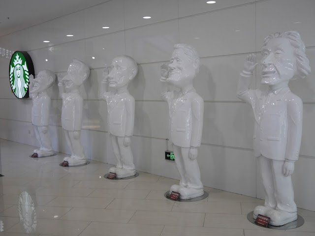 statues of world leaders at a mall in Dalian, China