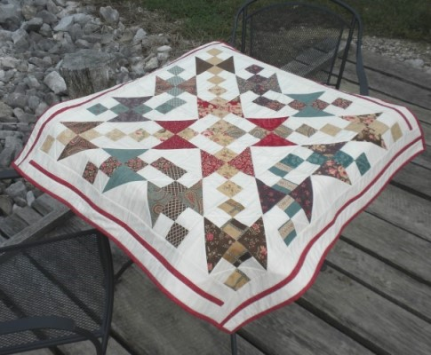 Scrappy Exploding Star Mat Quilt Free Pattern designed by Fabric Buffet