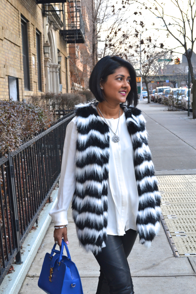 Mandee stores black and white fur vest