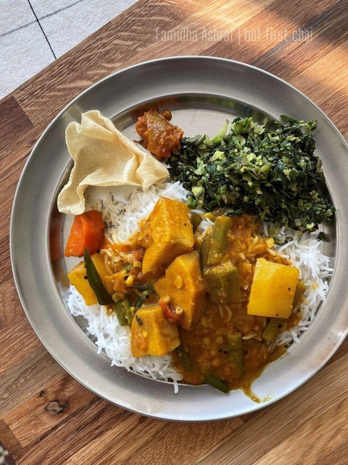 Sambar served with rice, cheera, pappadam and pickle