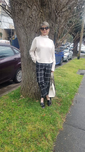HIGH NECK JUMPER AND CHECK PANTS FOR TRANSITIONAL SEASON