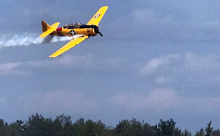 Navy SNJ trainer of World War II makes low-level pass.