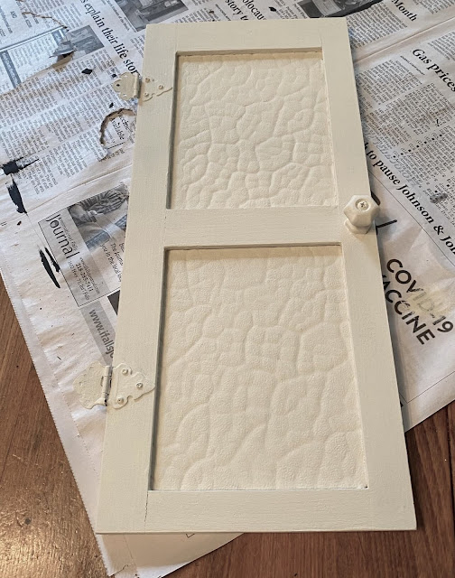 Photo of a small wall decor door painted off white