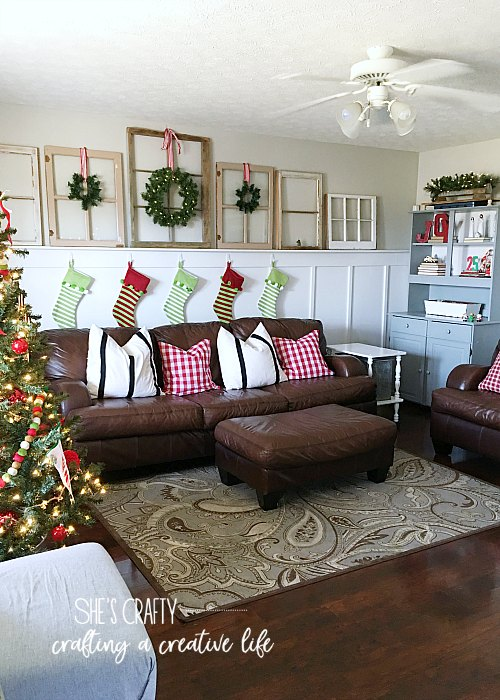 windows, brown leather couches, christmas tree, farmhouse decor