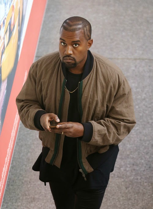 Kanye West wears arrow hairstyle