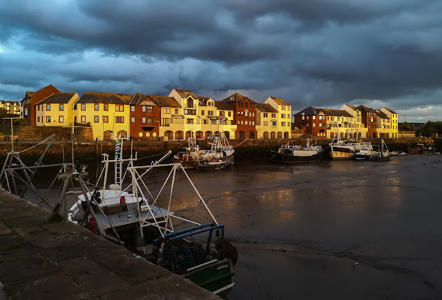 Photo of golden light on Maryport harbour