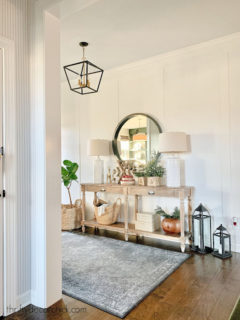 white foyer wall with wood console table