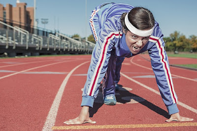 Runner Squatting Down Preparing to Take Off