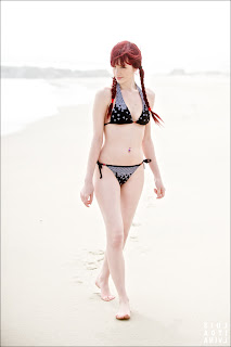 susan-coffey-at-beach-in-swimsuit-photo